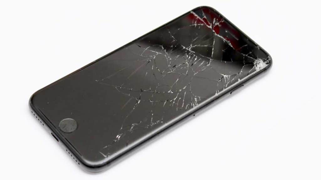 A cracked and broken iPhone 7 screen needs a repair after being dropped.