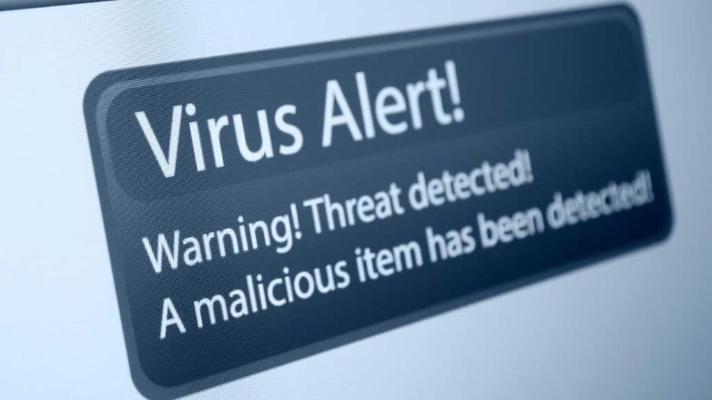 Computer virus detected alert screen message-on a monitor.
