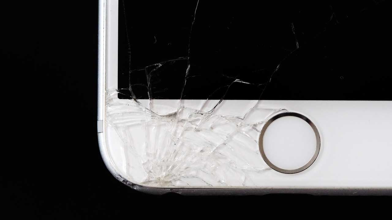 iPhone repair smashed screen around the home button.