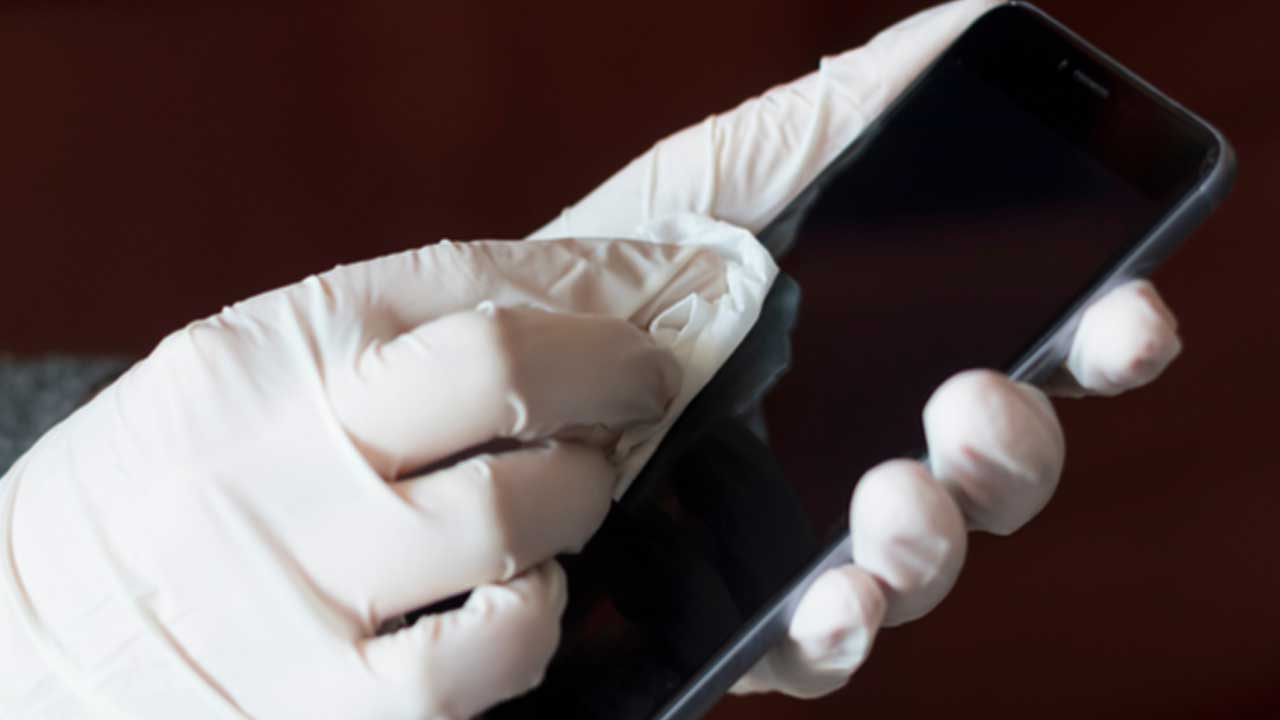 How to clean a phone screen with an anti bacterial wipe cloth.