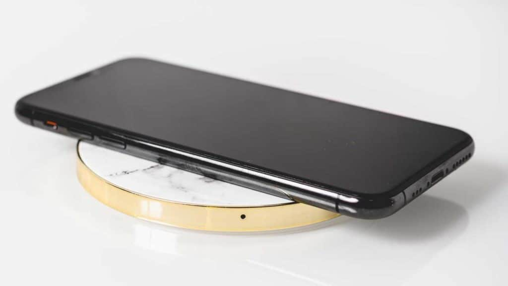 An iPhone wireless charging station on a table.
