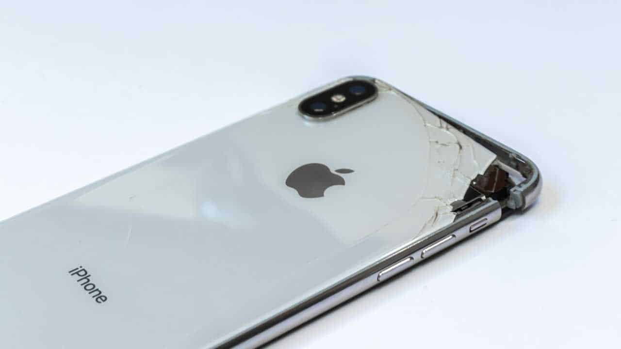 A broken iPhone back glass replacement is needed following a drop that caused a cracked casing.